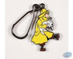 Tintin en imperméable sauve Milou