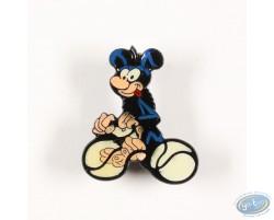 Bébé Marsupilami noir fait du vélo avec sa queue