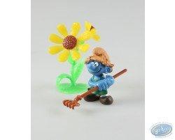 gardener with rake and flower